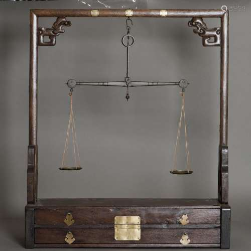 A CHINESE WOODEN SCALE