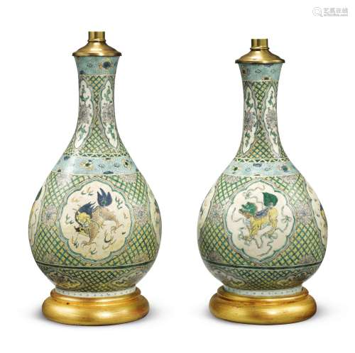 A pair of Chinese famille-verte pear-shaped vases, now mounted as lamps Qing Dynasty, Kangxi Period