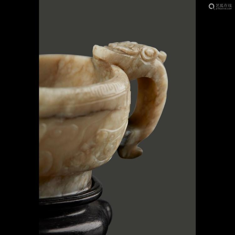 CARVED JADE ARCHAISTIC POURING VESSEL, YI 12.8cm long