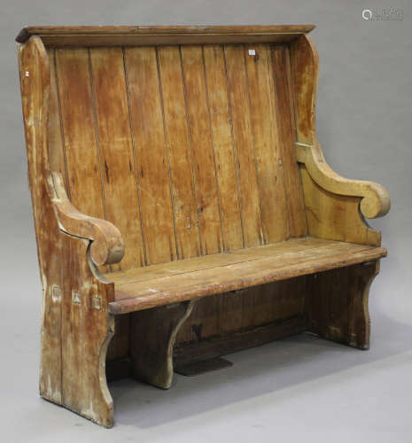 A late 19th century stripped pine settle