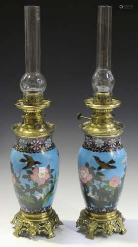 A pair of late 19th century Japanese cloisonné and French gilt metal mounted table oil lamps with ovoid bodies and pierced foliate feet