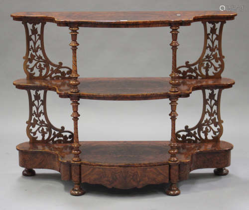 A mid-Victorian burr walnut three-tier whatnot