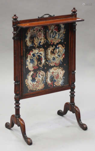 A Regency rosewood firescreen with tapestry inset panel