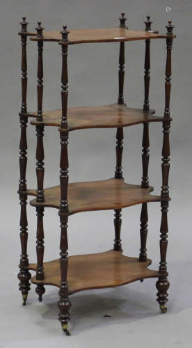 A Victorian walnut four-tier whatnot