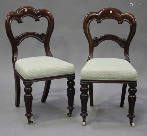 A set of six late Victorian mahogany spoon back dining chairs with overstuffed seats