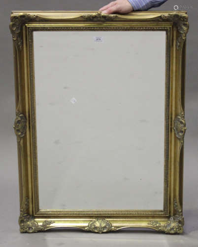 A late 20th century Victorian style gilt framed wall mirror with leaf scroll decoration