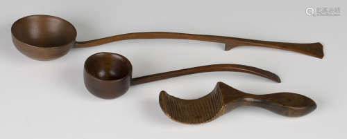 A 19th century ash measure/scoop with rounded bowl and curved handle