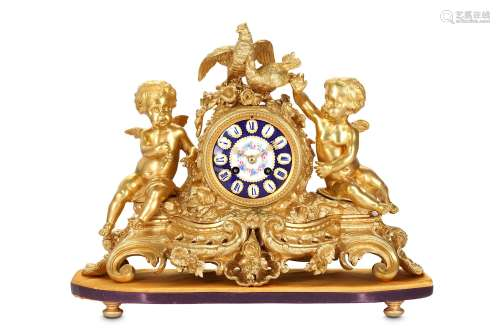 A THIRD QUARTER 19TH CENTURY GILT BRONZE AND PORCELAIN MANTEL CLOCKin the Rococo taste