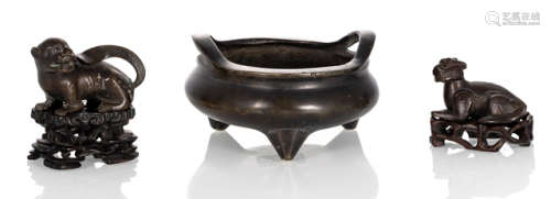 A BRONZE TRIPOD CENSER AND TWO ANIMAL-SHAPED PAPER WEIGHTS