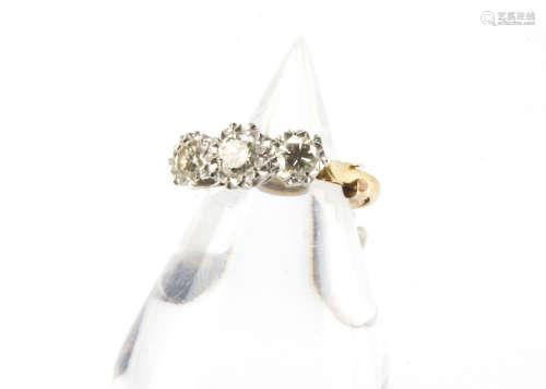 An Art Deco period three stone diamond engagement ring