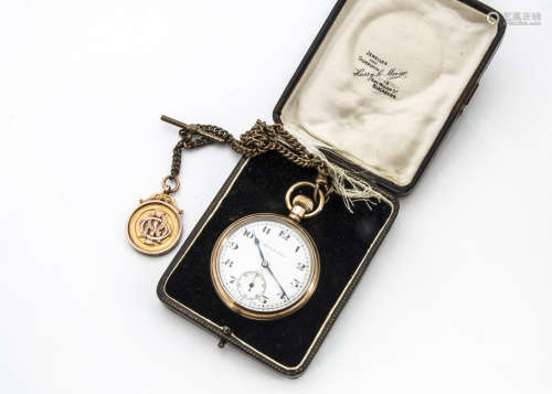An early 20th Century gold plated pocket watch in case retailed by Harry Le Maine