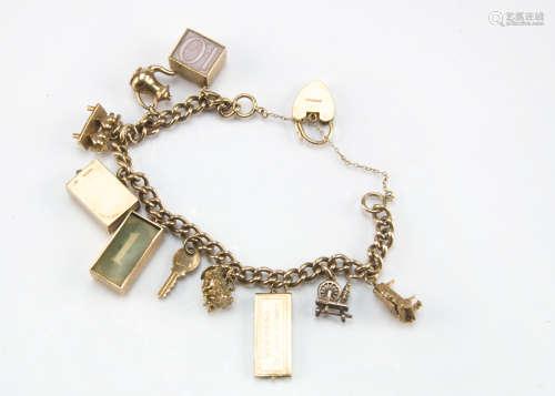 A vintage 9ct gold charm bracelet