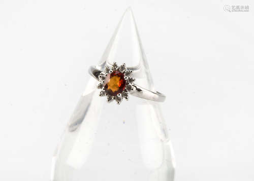 A modern 18ct white gold sunset sapphire and diamond cluster ring