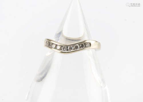 A modern 18ct white gold and diamond wishbone shaped half hoop eternity ring