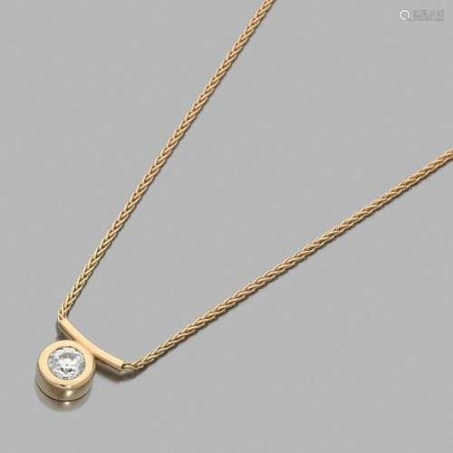 PENDENTIF DIAMANT A 3,12 carats diamond and gold pendant with chain.