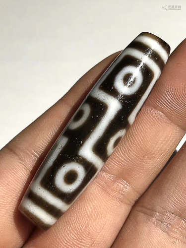 A CLASSICAL NINE-EYE DZI BEAD