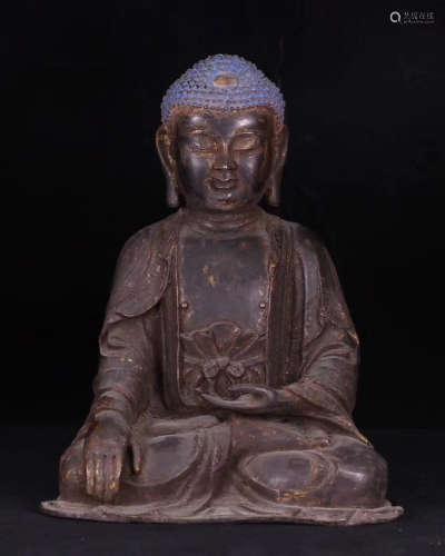 A BRONZE BUDDHA FIGURE