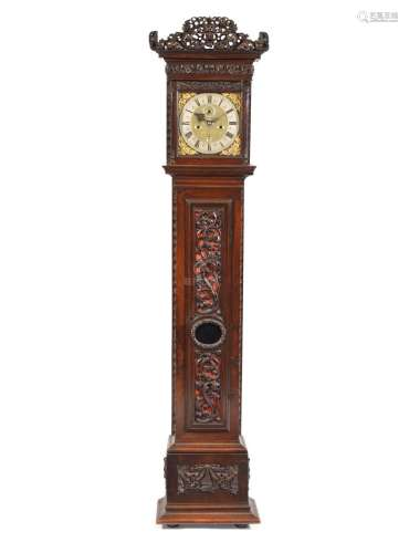 A fine and rare late 17th century carved walnut Dutch-striking longcase clock with alarm and calendar Fromanteel