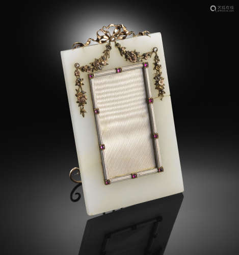 A hardstone frame by Fabergé, workmaster Karl Armfelt, the rectangular chalcedony frame (damaged)