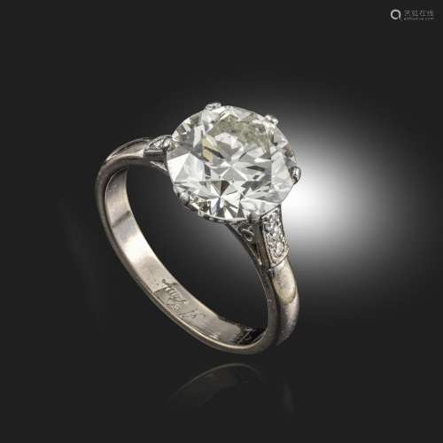 A diamond solitaire ring, the round brilliant-cut diamond weighs approximately 3.69cts, with three
