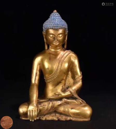 A GILT BRONZE MOLDED SAKYAMUNI BUDDHA STATUE