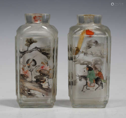 A pair of Chinese inside painted glass snuff bottles, 20th century, each of cut rectangular form,