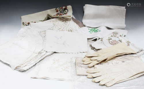 A small quantity of whitework, including linen tablecloths and placemats, two early 20th century