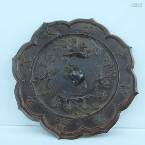 7-9TH CENTURY, A SUNFLOWER DESIGN MIRROR, TANG DYNASTY