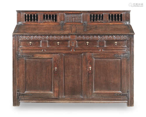 A rare James II joined oak and fruitwood clerks's cupboard, Lake District, dated 1686