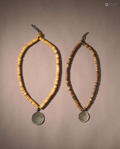 TWO BONE MALAS WITH SIPA-HO AMULETS