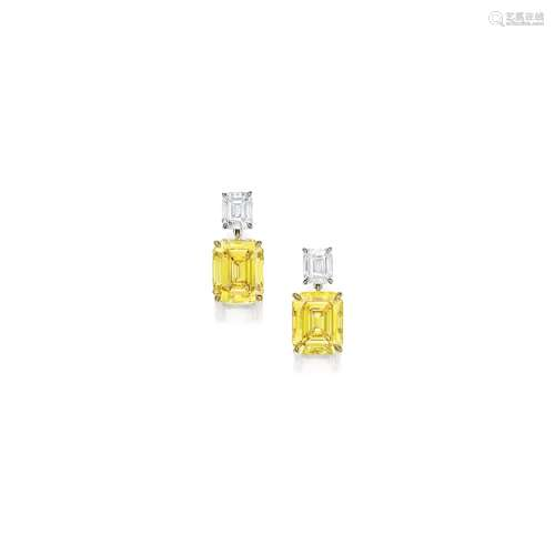 A Fine Pair of Fancy Vivid Yellow Diamond and Diamond Pendent Earrings