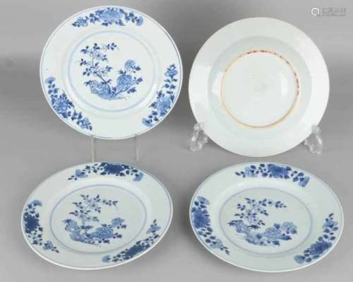 Four times 18th century Chinese porcelain plates with garden decors. Two plates of minimal chips.