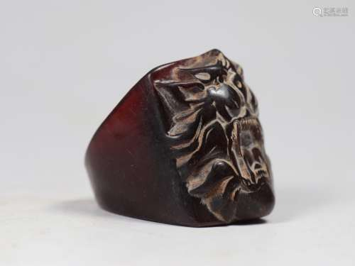 an ox horn carving lion statue ring
