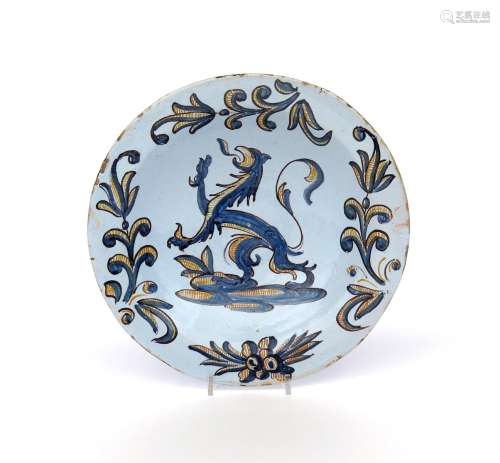 A Talavera or Puente del Arzobispo faïence dish c.1675, from the Three Colour Family, boldly painted