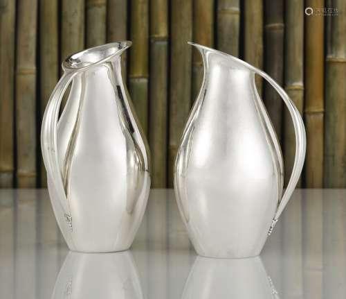 Two matching Danish silver pitchers no. 432A, designed by Johan Rohde, Georg Jensen Silversmithy, Copenhagen, 1925-32 and 1945-77