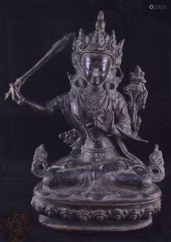 A BRONZE MOLDED BUDDHA STATUE