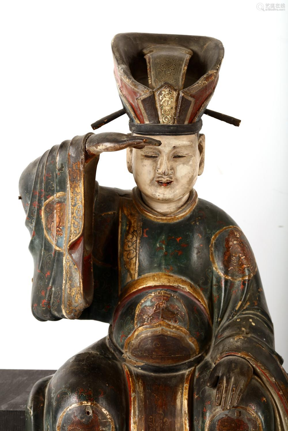 A PAIR OF CARVED WOODEN FIGURES OF BUDDHIST DEITIE