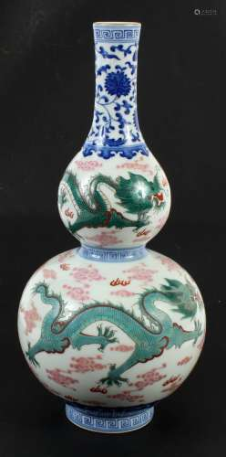 CHINESE PORCELAIN DOUBLE GOURD VASE - Showing red and green dragons vying for the flaming pearl amidst fire symbols and clouds.