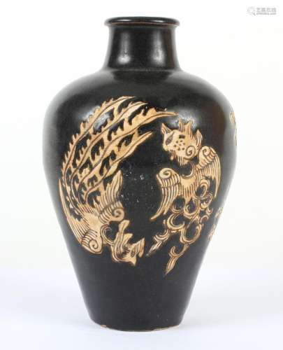 CHINESE PORCELAIN GALLIPOT SHAPED VASE -Having a dark brown/black ground with stylized phoenix inscribed/carved in light tan.