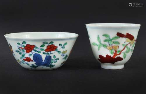 TWO SMALL DOUCAI TEACUPS - Chinese; different shapes; one decorated with rooster, hen and chicks, the second portrays a bird in a pe...