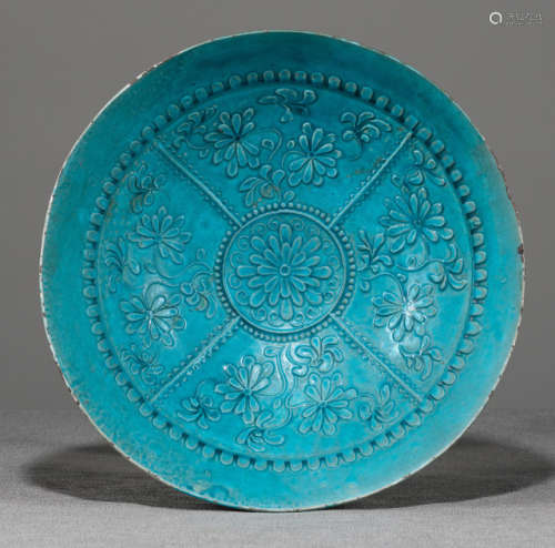 A LARGE TURQUOISE-GLAZED MOLDED POTTERY BOWL