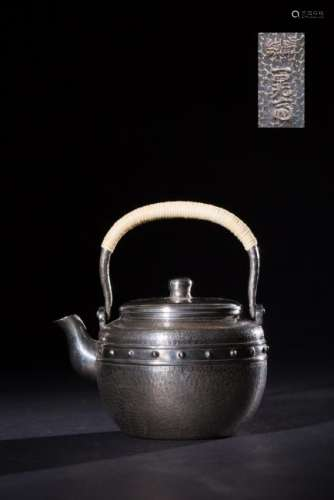 A SILVER MOLDED HANDLE WATER POT