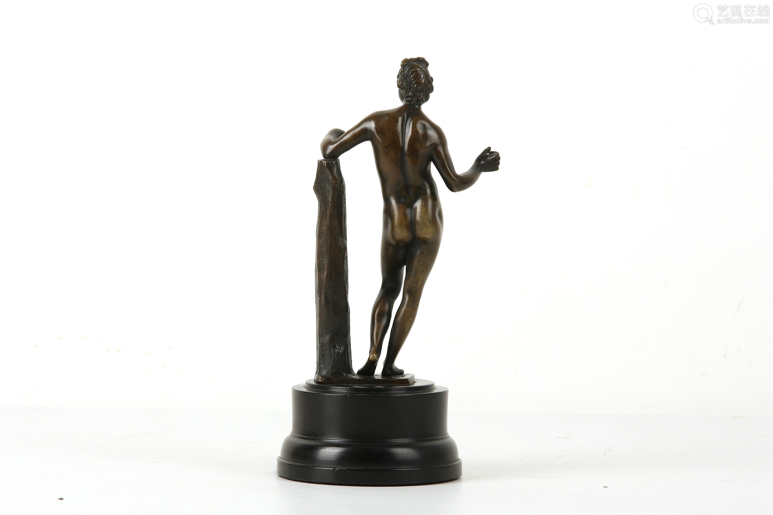 A LATE 18TH / EARLY 19TH CENTURY BRONZE STATUETTE OF APOLLO the standing nude figure with left arm