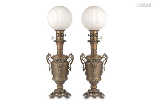 A PAIR OF LATE 19TH CENTURY BRONZE LAMP BASES WITH GLASS SHADES the oil lamp bases with removable