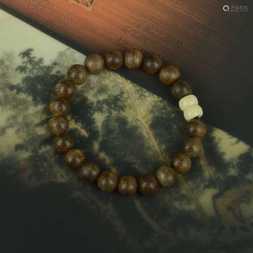 印尼加里曼丹沉香手串0.8cm(海马牙配珠)