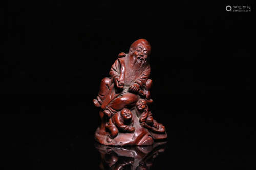 A BAMBOO CARVED CHARACTER PENDANT
