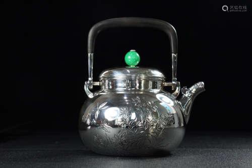 A SILVER CASTED AUSPICIOUS PATTERN TEA POT