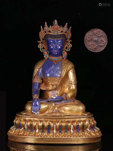 A GILT BRONZE LAZULI DECORATED LIFELESS BUDDHA