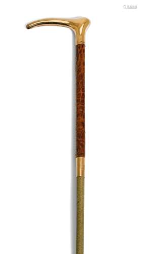 A 15ct gold-mounted riding whip, retailed by Swaine & Adeney, London, 1898