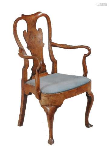 A George II walnut and upholstered arm chair, mid 18th century